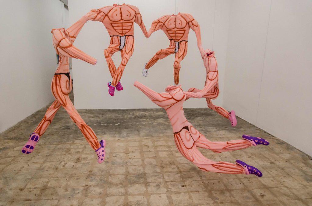 Bodies, 2019 Muscle suits, Croc shoes, PVC, mixed media 10 x 9 x 7 ft